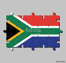 jigsaw puzzle of south africa flag in red and blue with a black triangle white and green horizontal y and gold against the triangle
