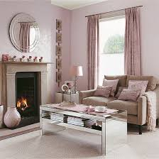 Shell pink living room with reflective accessories Create a warm, feminine  feel in a small