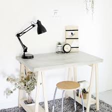 a concrete desk with wooden legs