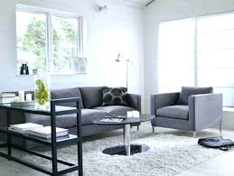 rugs with grey couch stirring white rug living room home