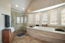 tub shower and shower bench in master bathroom