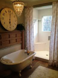 clawfoot unique bathtubs for small spaces with wall clock white rug under crystal pendant lamp