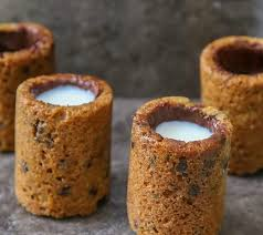 photo of two chocolate cookie shots filled with milk