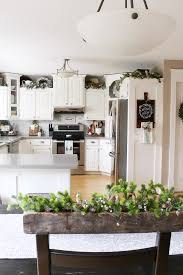 Kitchen decorating ideas Kitchen Cabinets Kitchen Christmas Decorations White Kitchen Dressed In Frosted Greens For Festive Touch Clean And Scentsible Christmas Kitchen Decorating Ideas Clean And Scentsible