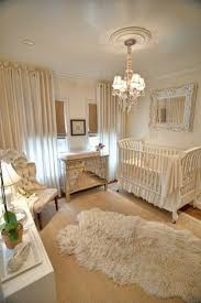 offwhite baby room furniture decor with chandelier cowhide rug mirror and curtains