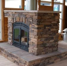rustic style outdoor wood burning fireplace utilizing closed hearth and brick mantles
