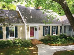 yellow house dark red door with cape cod built with vinyl siding traditional exterior other 21