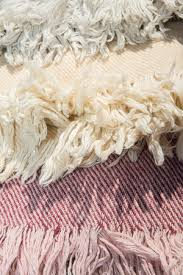 before we start just want you to know that the fringe tassels on hand woven rugs are the strands of silk or wool around which pile knots are twisted and