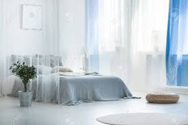 Decorative bed canopy in calm and relaxing bedroom with wicker..