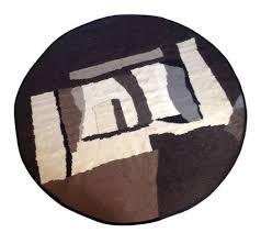 black white round rug by simona tavassi for eugenia pinna