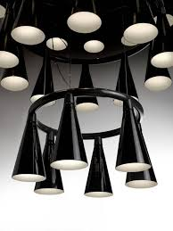 komori a chandelier reminiscent of a colony of bats hanging upside down from a tree