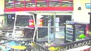 now playing robbers drive truck through window to try to steal atm