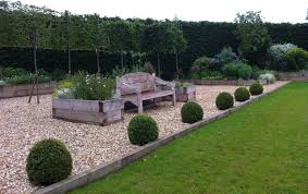 Small Picture Hornbeam High panel hedging behind an oversized antique bench and