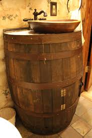 Bathroom Decorating. We took an old wine barrel and old wooden bowl and  made it