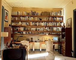 home office bookshelves. view of well stocked bookshelves in a home office b