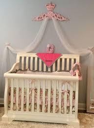 on her blog nicole says i m in love with her crib sheets and curtains that i got to customize for her pink and fl