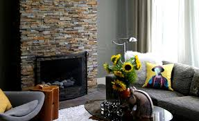 natural stacked stone veneer fireplace in a living room made with stacked stone fireplace surround kit