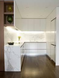 Small modern kitchen designs - Small minimalist u-shaped dark wood floor  kitchen photo in