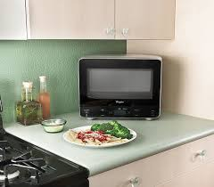 fits easily into corners to maximize counter space this sleek microwave s unique rounded back allows it to fit into corners making it ideal for tight