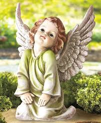 add a bit of serenity to your outdoor decor with the angelic garden statue this intricately detailed cherub is a lovely addition to any outdoor or memorial