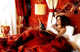 Sensual Bedroom Sexy Woman In A Luxury Bedroom With A Bottle Of Champagne Stock