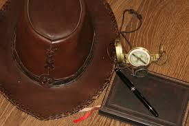 leather clock time adventure travel brown bag compass clothing handbag bridle textile emotion heading entrepreneur uncertainty