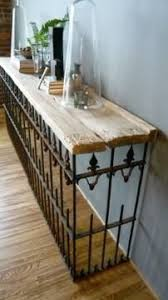 wrought iron and wood furniture. salvaged wood wrought iron fence u003d console table maybe put potted plants in fenced and furniture y