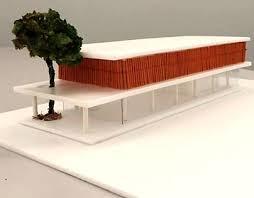 Um térreo livre com grandes portas de vidro deslizantes e que sustenta uma caixa de madeira delimitada por lajes de concreto. Toblerone Projects Photos Videos Logos Illustrations And Branding On Behance