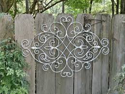 cur white shabby chic metal wall decor fleur de lis patio indoor regarding