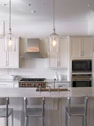 traditional kitchen idea in new orleans with shaker cabinetarble countertops