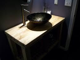 cream wallpaper design black small real wood vanity with storage drawers ceramic flooring tile white granite bathroom
