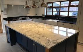 how stunning is this super white dolomite island complemented by angola black granite worktops