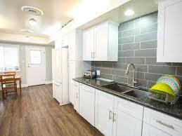 black quartz countertops with white cabinets