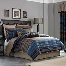 modern navy brown and blue bed comforters for men with dark brown leather on tufted headboard