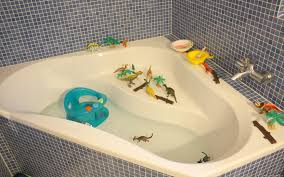 bath with dinosaurs and paint children bath time fun