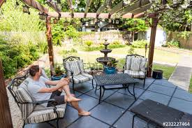 young man sitting on patio lounge chair