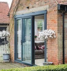 a beautiful set of black aluminium bi folding doors slightly open