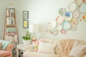 a pretty plate display above the sofa