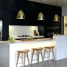 hanging lights for kitchen islands gold pendants bring lots of warmth into this modern kitchen hanging hanging lights for kitchen