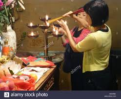 alter lighting. Chinese Ancestor Worship Lighting Incense On The Alter