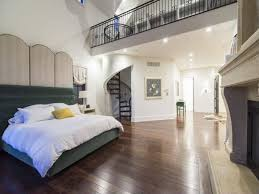 Loft inside the bedroom which is used for a massive closet accessible via  spiral staircase