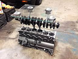 3 straight six goodness complimented by a crankshaft and pistons 10 coffee tables