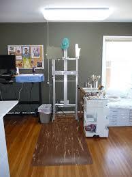painting studio lighting. studio with new cushy floor mat lighting and dark painted wall painting a