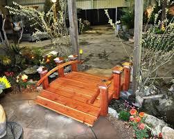 rich wood garden bridget for crossing backyard garden river photograph