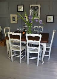 vine french extending dining table with 6 straw seat chairs artwork