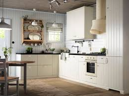off white country kitchen. An Off-white Country Kitchen With Black Worktops. Combined Oven Off White P