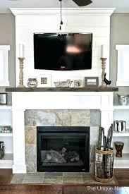 tv on mantle best above the fireplace images by on mounting walls and cloaks