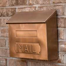 wall mounted mailbox in bronze with brick wall for exterior design ideas