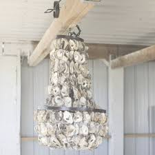 mesmerizing beach themed chandelier 69 in interior for house with have to do with beach