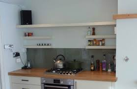 kitchen shelf. simple white kitchen wall shelf design combined with laminated wooden countertop and stainless cooktop